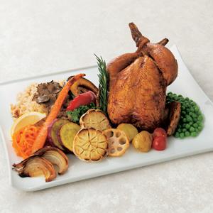 ≪寛リナト≫黒トリュフのガーリックバターライスを詰め込んだ丸鶏ロースト グリル野菜添え